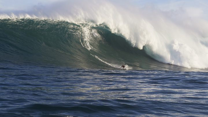 This Photographer Shoots 70-Foot Waves on His Surfboard