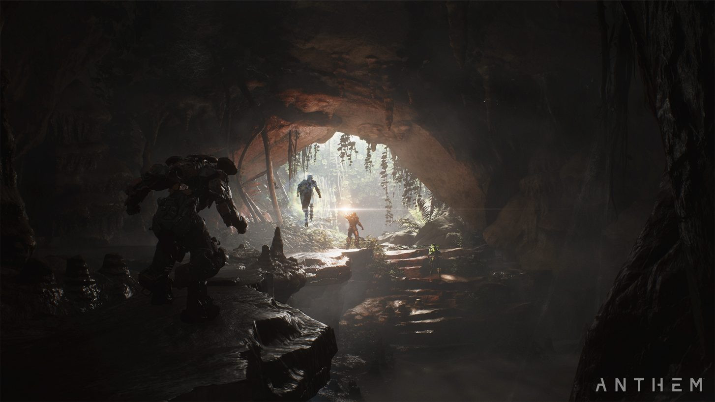 Javelin suits fly through the mouth of a dimly lit cave in Anthem