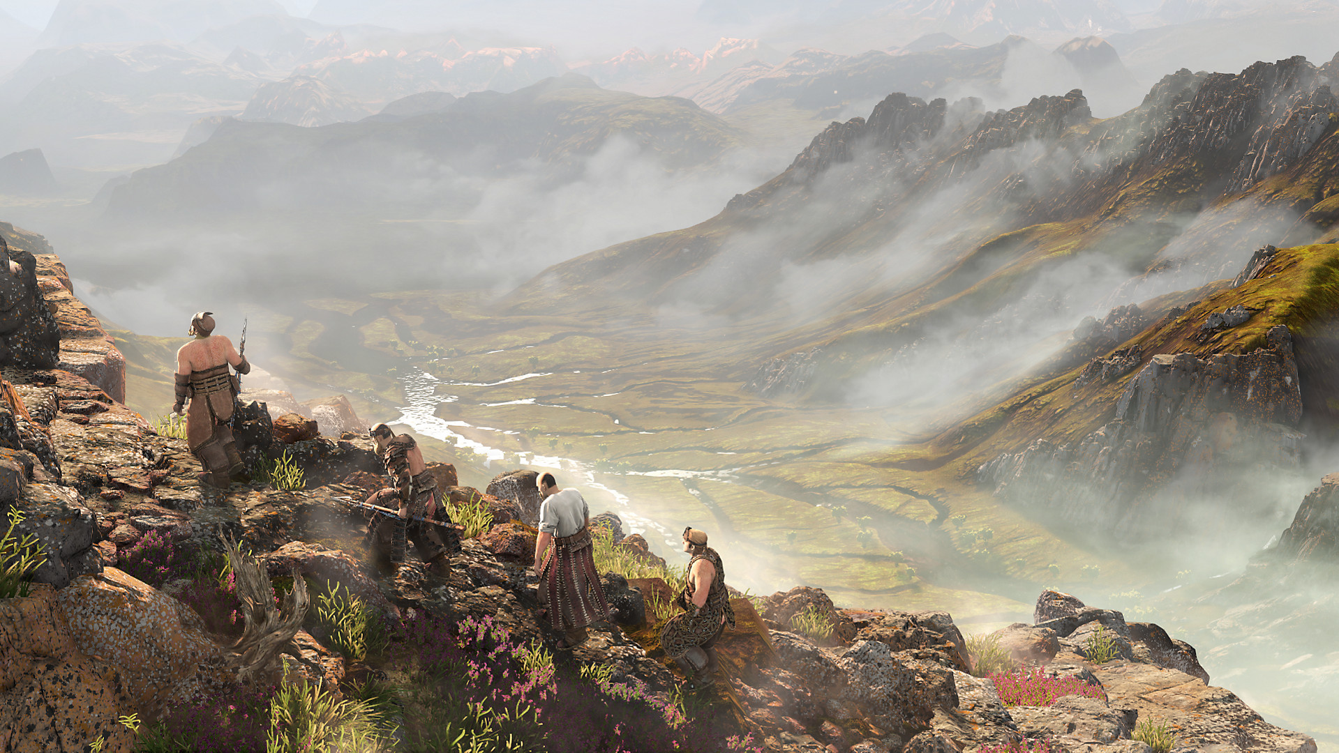 A group of figures move across a rocky mountain spine in Horizon Zero Dawn, with a cloudy valley far below